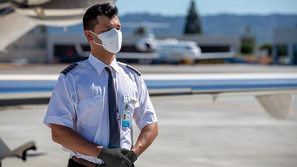 private pilot on tarmac wearing mask and gloves