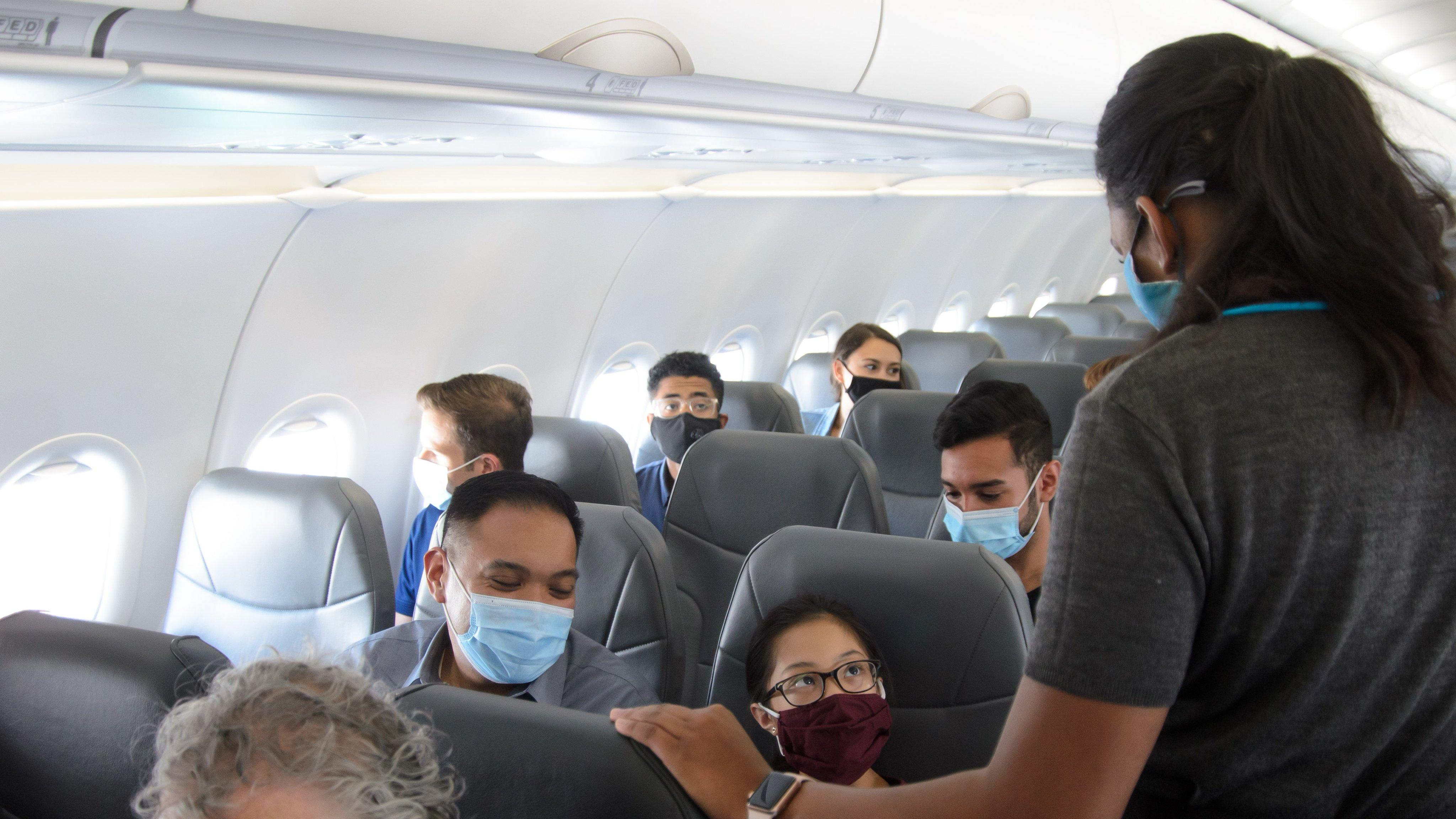 Frontier Airlines passengers with masks